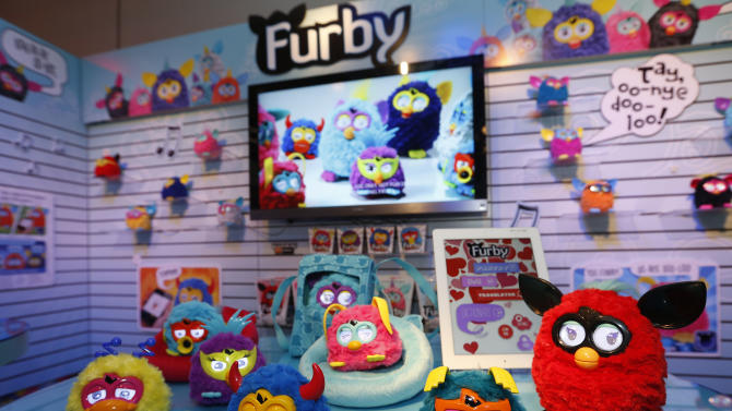 IMADE DISTRIBUTED FOR HASBRO - FURBY PARTY ROCKERS creatures rock out in Hasbro's showroom at the American International Toy Fair, Sunday, Feb. 10, 2013, in New York.  Available this month, each of these funky friends has its own personality, and make a lively companion for the FURBY toy. (Photo by Jason DeCrow/Invision for Hasbro/AP Images)