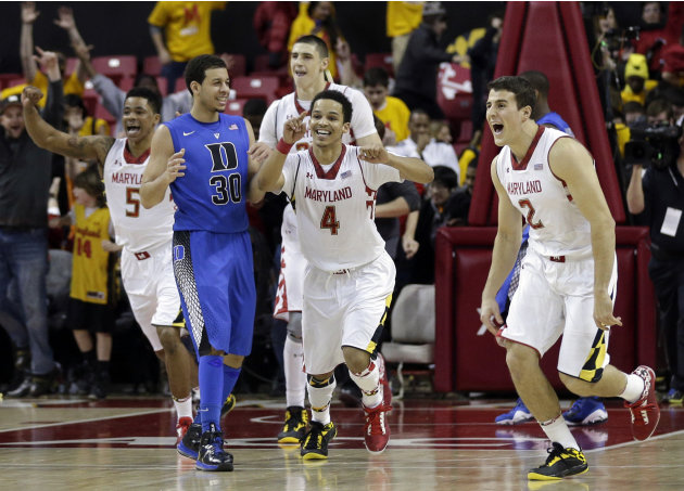 Maryland's Nick Faust (5), Seth Allen (4) and Logan Aronhalt (2) celebrate in front of Duke guard Seth Curry after beating Duke 83-81 in an NCAA college basketball game in College Park, Md., Saturday,