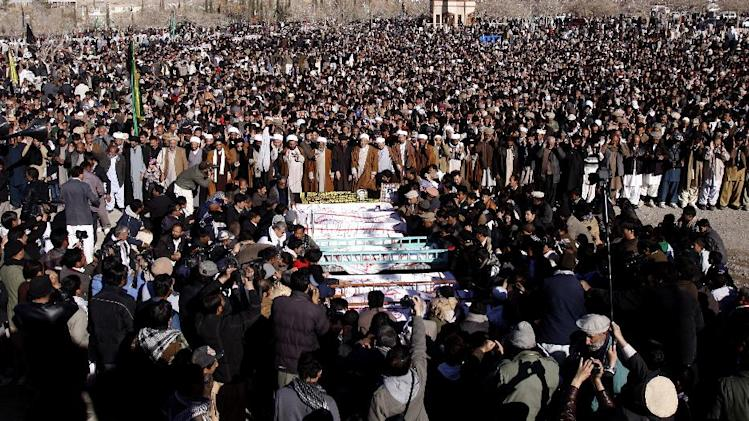 Pakistani Shiite Muslims offer funeral prayers for victims of Thursday's twin bombings in Quetta, Pakistan, Monday, Jan. 14, 2013. Thousands of Shiites finally ended a three-day long protest in the southwestern city of Quetta, in which they demanded better security following an attack that killed tens of people. (AP Photo/Arshad Butt)