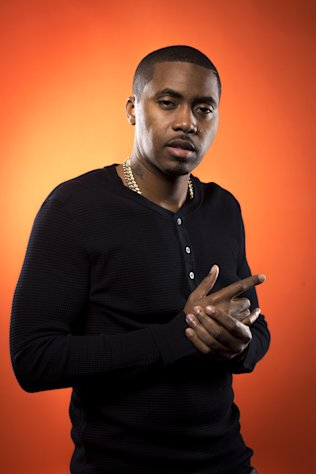 This Dec. 20, 2012 photo shows American rapper and actor Nas, born Nasir Jones, in New York. Nas is nominated for four Grammys, including best rap album for Life Is Good, best rap song and best rap performance for Daughters, and best rap/sung collaboration for Cherry Wine, which features the late Amy Winehouse. The Grammy Awards will air live Feb. 10. (Photo by Scott Gries/Invision/AP Images)