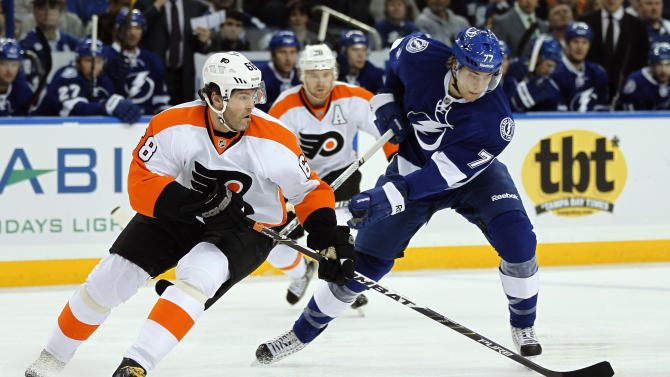 Tampa Bay Lightning defenseman Victor Hedman (77), of Sweden, strips the puck away from Philadelphia Flyers right wing Jaromir Jagr (68), of the Czech Republic, during the first period of an NHL hockey game Tuesday Dec. 27, 2011, in Tampa, Fla. Hedman left the game with an upper body injury. (AP Photo/Chris O'Meara)