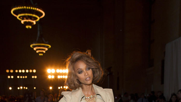 Tyra Banks attends the FIJI Water-sponsored Marchesa Spring 2013 Fashion Show at Vanderbilt Hall on Wednesday Sept. 12, 2012, in New York. (Photo by Victoria Will/Invision for FIJi Water /AP Images)