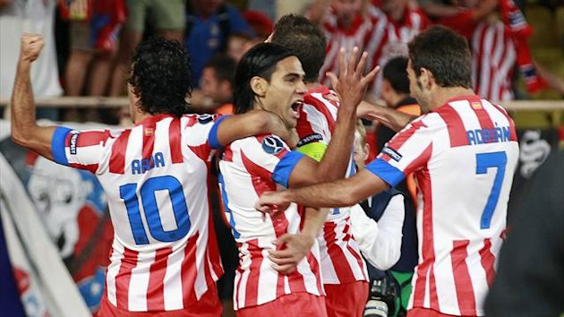 Atletico Madrid's Falcao (9) celebrates with team mates after scoring against Chelsea (Reuters)