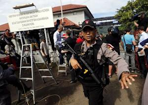 An Indonesian policeman stands guard in front of Wijayapura…
