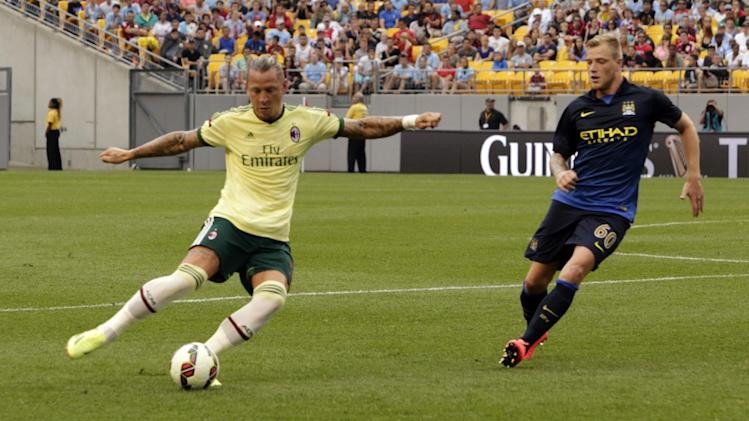 IMAGE DISTRIBUTED FOR GUINNESS INTERNATIONAL CHAMPIONS CUP - AC Milan's Philippe Mexes (5) and Manchester City's John Guidetti (60) during Guinness International Champions Cup game against Manchester City vs. AC Milan, on Sunday, July 27, 2014 at Heinz Field in Pittsburgh, Pa. Manchester City won the match 5-1. (Ed Rieker/AP Images for Guinness International Champions Cup)