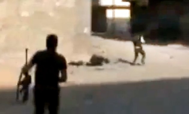 This image made from amateur video released by the Ugarit News and accessed Sunday, July 15, 2012, purports to show Free Syrian Army soldiers during clashes with Syrian government forces in Damascus, Syria. Syrian troops and rebels clashed inside Damascus for a second day on Monday, causing plumes of black smoke to drift over the city's skyline in some of the worst violence in the tightly controlled capital since the country's crisis began 16 months ago. (AP Photo/Ugarit News via AP video) TV OUT, THE ASSOCIATED PRESS CANNOT INDEPENDENTLY VERIFY THE CONTENT, DATE, LOCATION OR AUTHENTICITY OF THIS MATERIAL