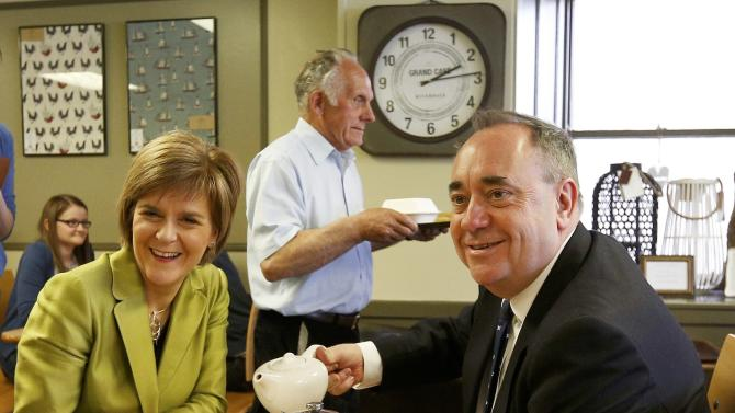 The leader of the Scottish National Party (SNP) Nicola Sturgeon and former leader and local candidate Alex Salmond stop for a cup of tea during campaigning in Inverurie, Aberdeenshire
