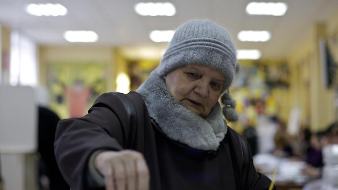 Nadezhda Viktorovna votes at a polling station in central Moscow, Russia, Sunday, March 4, 2012. Polling stations have opened across Russia for the presidential elections widely expected to return Vladimir Putin to the Kremlin as President. (AP Photo/Harry Engels)