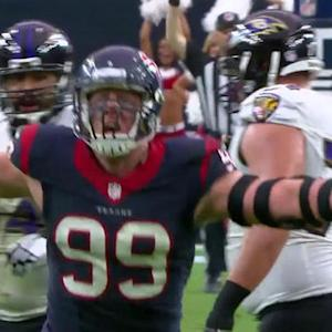 Houston Texans defensive end J.J. Watt sacks Baltimore Ravens quarterback Joe Flacco on 4th down