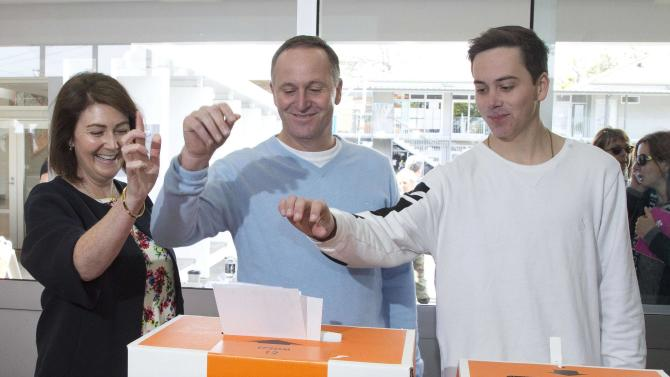 New Zealand's National Party leader John Key casts his vote with his wife Bronagh and his son Max on election day during New Zealand's general election in Auckland
