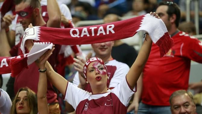 Fan of Qatar cheers before their semi-final match against Poland at the 24th Men's Handball World Championship in Doha