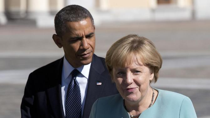 FILE - In this Sept. 6, 2013 file photo, President Barack Obama walks with Germany's Chancellor Angela Merkel toward a group photo outside of the Konstantin Palace in St. Petersburg. In geopolitics just as on the local playground, even best friends don't tell each other everything. And everybody's dying to know what the other guy knows. Revelations that the U.S. was monitoring the cellphone calls of up to 35 world leaders, including close allies, have brought into high relief the open-yet-often-unspoken secret _ and suggested the incredible reach of new-millennium technology. (AP Photo/Alexander Zemlianichenko, File)