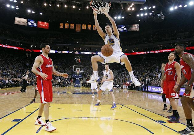 Golden State Warriors' Klay Thompson (11) dunks against the Los Angeles Clippers during the second half of an NBA basketball game on Thursday, Jan. 30, 2014, in Oakland, Calif. Golden State won 11