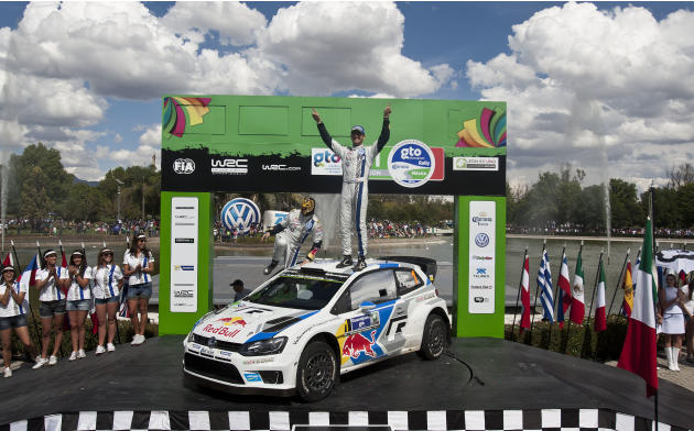 Volkswagen Motorsport team driver Sebastian Ogier, right, and co-driver Julien Ingrassia, both from France, celebrate on their car after winning the Mexico Rally in Leon, Mexico, Sunday, March 9, 2014