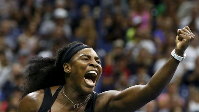 Williams of the U.S. reacts during her match against Mattek-Sands of the U.S. at the U.S. Open Championships tennis tournament in New York