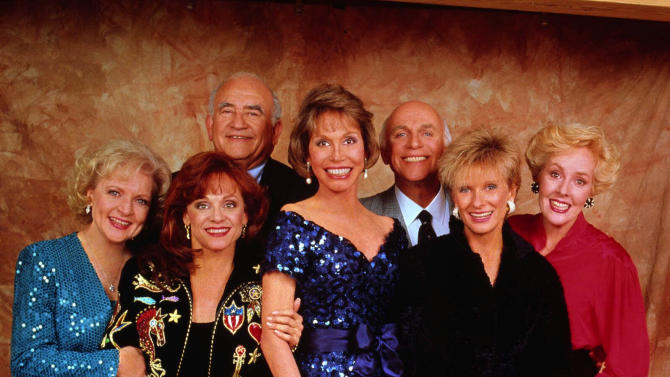 "FILE - This undated handout publicity photo shows, from left, Betty White, Valerie Harper, Ed Asner, Mary Tyler Moore, Gavin MacLeod, Cloris Leachman and Georgia Engel, the original cast of the ""Mary Tyler Moore Show.""  White reunites with her former co-stars, Mary Tyler Moore, Cloris Leachman, Georgia Engel and Valerie Harper for an upcoming episode of  ""Hot in Cleveland."" (AP Photo, File)"