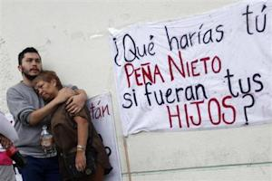 Relatives of one of 12 people abducted in May, mourn outside the Attorney General building in Mexico City