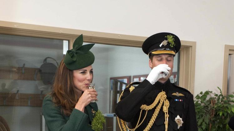Britain's Prince William and his wife Catherine, Duchess of Cambridge drink during a visit to the 1st Battalion Irish Guards for a St Patrick's Day Parade at Mons Barracks in Aldershot