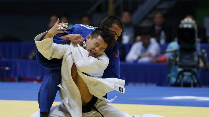 South Korea's Choi Gwang-hyeon competes with Kazakhstan's Azamat Mukanov in their men's team gold medal judo contest at Dowon Gymnasium during the 17th Asian Games in Incheon