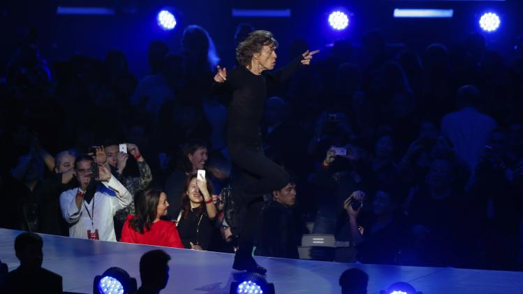 Mick Jagger of the Rolling Stones performs as fans take pictures during a concert in Shanghai
