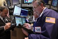 Traders work on the floor of the New York Stock Exchange on April 10. US stocks sank more than one percent in a Friday the 13th rout as slower growth in China eclipsed better-than-expected earnings from two big banks and Internet giant Google