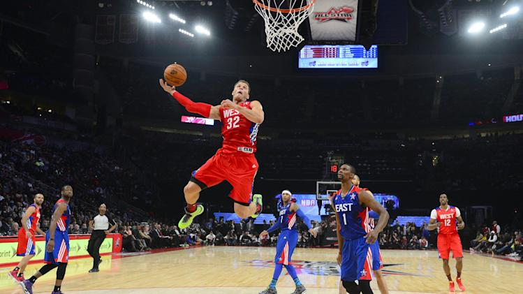 West Team's Blake Griffin of the Los Angeles Clippers goes up for a shot against East Team's Chris Bosh of the Miami Heat during the first half of the NBA All-Star basketball game Sunday, Feb. 17, 2013, in Houston. (AP Photo/Bob Donnan, Pool)