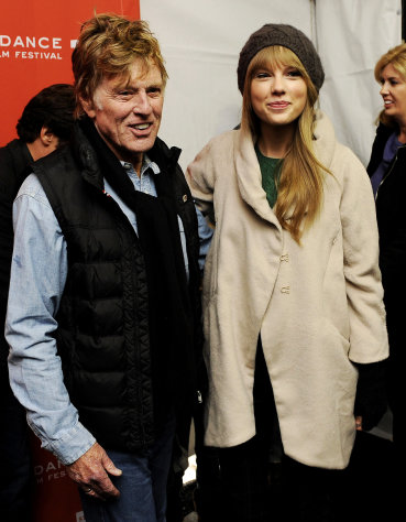 FILE - In this Jan. 20, 2012 file photo, Robert Redford poses with singer Taylor Swift at the premiere of the documentary film &quot;Ethel&quot; at the 2012 Sundance Film Festival in Park City, Utah. (AP Photo/Chris Pizzello, File)