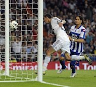Real Madrid midfielder Angel di Maria (L) scores during their Spanish League match on September 30. It was Di Maria himself who put his team ahead and then Cristiano Ronaldo got his second shortly before the break