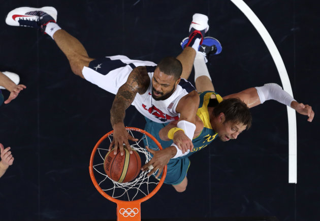 In this Wednesday, Aug. 8, 2012 file photo, United States' Tyson Chandler dunks against Australia's David Andersen during a men's quarterfinals basketball game at the 2012 Summer Olympics, in London. (AP Photo/Charles Krupa, File)