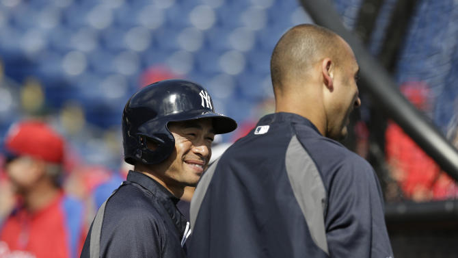New York Yankees right fielder Ichiro Suzuki, left, and New York Yankees shortstop Derek Jeter chat during batting pracrtice before a spring training baseball game between the Yankees and the Phillies in Clearwater, Fla., Tuesday, March 19, 2013.  (AP Photo/Kathy Willens)