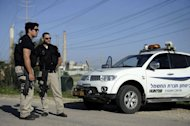 "Israeli security forces patrol the southern city of Ashkelon on February 26, 2013. Gaza militants from Fatah's Al-Aqsa Martyrs Brigades have fired a rocket at Israel in a ""preliminary"" step after one of its men died following an Israeli interrogation"