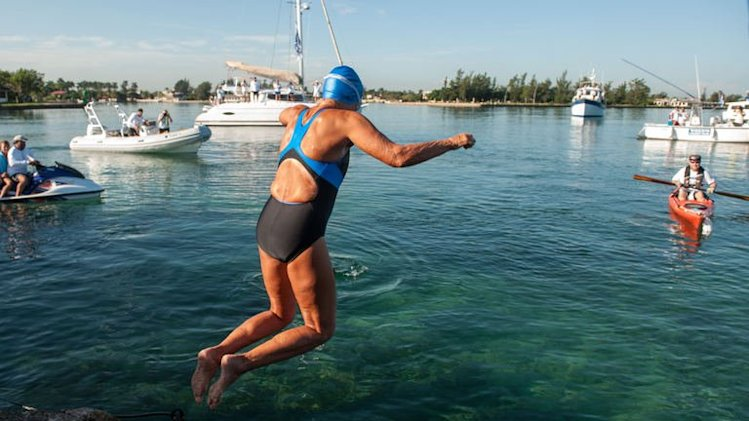 US swimmer Diana Nyad jumps into the water at the Ernest Hemingway Nautical Club, in Havana on August 31, 2013