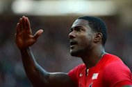 USA's Justin Gatlin reacts after competing in the men's 100m semi-finals at the athletics event during the London 2012 Olympic Games in London. Reigning champion Usain Bolt coasted into the 100m final with apparent ease Sunday as Gatlin led the timings for an Olympics showdown featuring the four fastest men in history