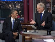 "US President Barack Obama and David Letterman speak during the ""Late Show with David Letterman"" at the Ed Sullivan Theater on September 18, 2012 in New York, New York. The White House could barely suppress its glee after the first excerpts emerged on Monday evening with Romney saying 47 percent of Americans are essentially freeloaders who will vote for the president ""no matter what."""