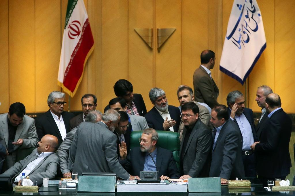 Fiery scenes as Iran MPs give partial nod to nuclear deal