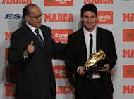 Lionel Messi (R) receives the European Golden Boot 2012 award from former footballer Luis Suarez in Barcelona on Monday. Messi heads a 23-strong shortlist for a fourth FIFA/France Football Ballon d'Or (Golden Ball) award