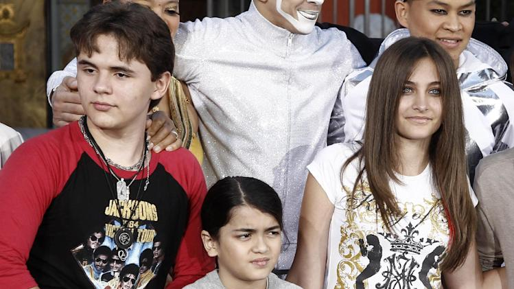 "FILE - This Jan. 26, 2012 file photo shows, from left, Prince Jackson, Blanket Jackson and Paris Jackson after a hand and footprint ceremony honoring their father musician Michael Jackson in front of Grauman's Chinese Theatre in Los Angeles. The executors of Michael Jackson's estate say they are concerned about the welfare of the singer's mother and his three children. In a letter posted on fan sites Tuesday, July 24, executors John Branca and John McClain says they are doing what they can to protect them from ""undue influences, bullying, greed, and other unfortunate circumstances."" The letter came hours after sheriff's deputies responded for a family disturbance at the hilltop home where Katherine Jackson and her three grandchildren live. No arrests were made, but there is an active battery investigation. Katherine Jackson was reported missing over the weekend, but is with relatives in Arizona. (AP Photo/Matt Sayles)"