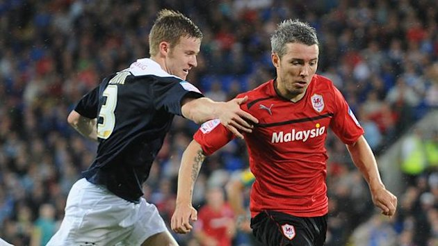 Cardiff City's Kevin McNaughton (right) and Huddersfield Town's Paul Dixon battle for the ball (PA Photos)