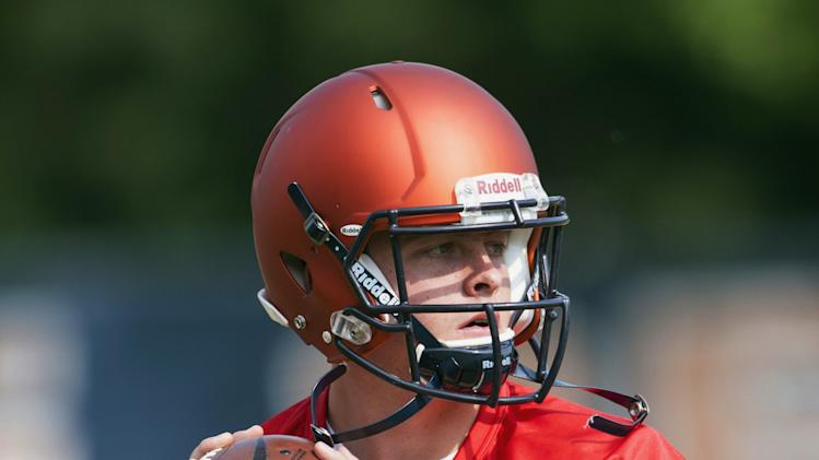 FILE - In this Aug. 4, 2014 file photo, Illinois quarterback Wes Lunt drops back to throw a pass during football practice at Memorial Stadium in Champaign, Ill. Lunt, a transfer from Oklahoma State, will start his first game for the Illini when they host Youngstown State on Aug. 30. (AP Photo/News-Gazette, John Dixon) MANDATORY CREDIT