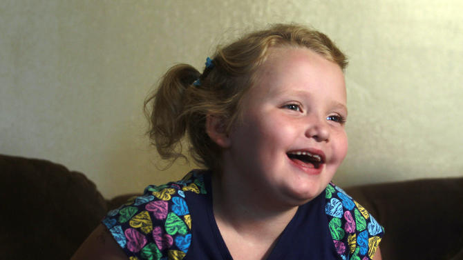 "In this photo taken Monday, Sept. 10, 2012, seven-year-old beauty pageant regular and reality show star Alana ""Honey Boo Boo"" Thompson gestures during an interview in her home in McIntyre, Ga. The reality show ""Here Comes Honey Boo Boo"" has been a ratings winner in recent weeks, capitalizing on redneck stereotypes and the oversized personality of Thompson. (AP Photo/John Bazemore)"