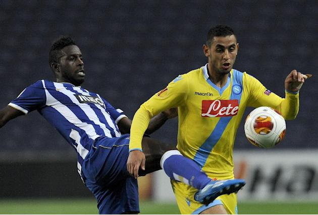 Napoli's Faouzi Ghoulam, right, challenges FC Porto's Silvestre Varela, left, during their Europa League round of 16, first leg soccer match at the Dragao stadium, in Porto, Portugal, Thursday