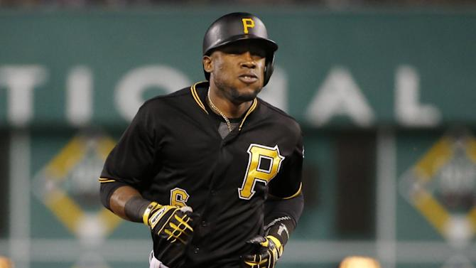 Pittsburgh Pirates' Starling Marte rounds second after hitting a three-run home run off Brewers starting pitcher Kyle Lohse in the fifth inning of a baseball game in Pittsburgh, Saturday, April 18, 2015. (AP Photo/Gene J. Puskar)