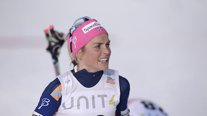 Therese Johaug of Norway reacts after completing the Ladies' Individual Free Cross Country 5km competition at the FIS World Cup Ruka Nordic 2015 event in Kuusamo