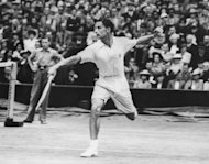"Bristish tennis player H.W ""Bunny"" Austin in action in his winning Wimbledon final against American Donald Budge in July 1938. Seventy-four years on, Andy Murray has ended Britain's long wait for a British finalist"