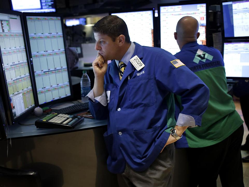 In this Sept. 3, 2013, photo, traders work on the floor at the New York Stock Exchange in New York. Stock markets were tentative Friday, Sept. 6, 2012, ahead of the latest U.S. jobs report, the most important monthly indicator for the world's largest economy. (AP Photo/Seth Wenig)