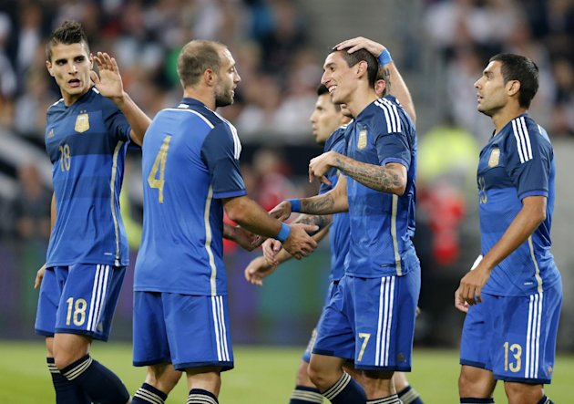 Argentina's players celebrate their side's fourth goal by Angel Di Maria, 2nd right, during the friendly soccer match between Germany and Argentina in...
