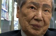 Sunao Tsuboi, who was 20 when he suffered terrible radiation burns in the atomic bombing of Hiroshima at the end of World War II, speaks in his office in the western Japanese city on March 25, 2011. The scars that still mark Tsuboi&#39;s face are a grim reminder of the power of the atom as a wave of nuclear wariness sweeps post-Fukushima Japan