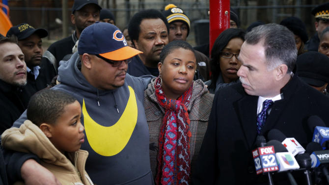 Chicago Police Superintendent Garry McCarthy, right, offers the city's condolences to the Pendelton family, from left, Nathaniel Jr., Nathaniel Sr., and Cleopatra during a news conference seeking help from the public in solving the murder of Pendelton's daughter Hadiya Wednesday, Jan. 30, 2013, in Chicago. Hadiya, 15, who had performed in President Barack Obama's inauguration festivities, was killed in a Chicago park as she talked with friends by a gunman who apparently was not even aiming at her. The city's 42nd slaying is part of Chicago's bloodiest January in more than a decade, following on the heels of 2012, which ended with more than 500 homicides for the first time since 2008. It also comes at a time when Obama, spurred by the Connecticut elementary school massacre in December, is actively pushing for tougher gun laws. (AP Photo/Charles Rex Arbogast)