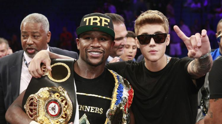 Mayweather Jr. and Bieber celebrate Mayweather's victory over WBC/WBA 154-pound champion Alvarez at the MGM Grand Garden Arena in Las Vegas, Nevada
