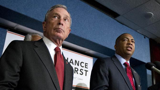 """New York City Mayor Michael Bloomberg, left, and incoming Florida Senate Minority Leader Chris Smith, take pat in a news conference at the National Press Club in Washington, Wednesday, April 11, 2012, to announce a nationwide campaign to reform or repeal Florida-style """"Shoot First"""" laws that have passed in states across the country.    (AP Photo Manuel Balce Ceneta)"""